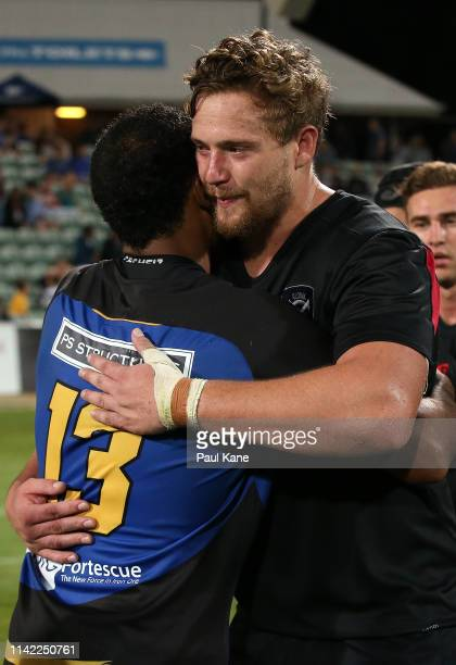 Marcel Brache of the Force and Louis Conradie of the Dragons embrace following the Rapid Rugby match between the Western Force and the Asia Pacific...