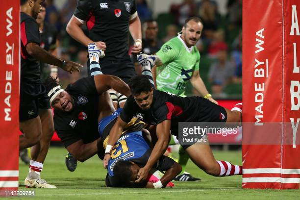 Marcel Brache of the Force gets tackled by Nili Latu and Kali Hala of the Dragons during the Rapid Rugby match between the Western Force and the Asia...