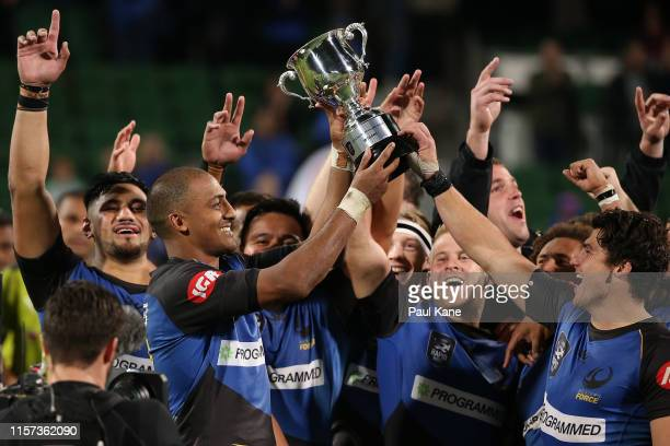 Marcel Brache of the Force holds the Pacific Showcase Series trophy aloft after winning the series and the Rapid Rugby match between the Western...