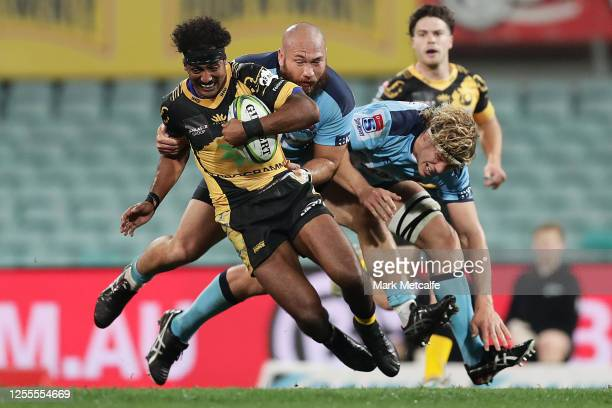 Marcel Brache of the Force Is tackled by Robbie Abel of the Waratahs during the round 2 Super Rugby AU match between the Waratahs and the Western...
