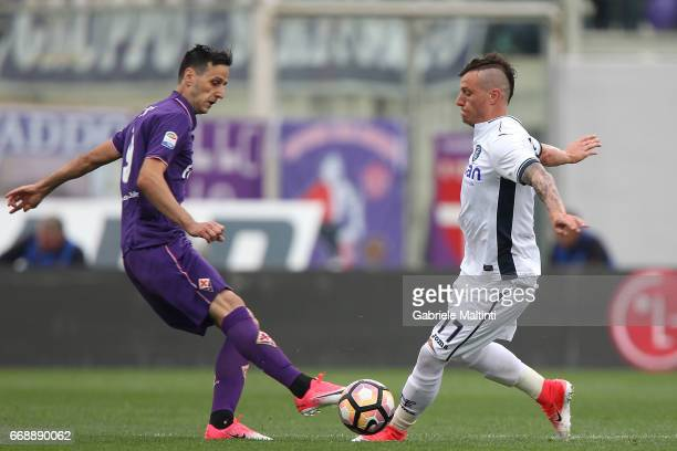 Marcel Buchel of Empoli FC in action against Nikola Kalinic of ACF Fiorentina during the Serie A match between ACF Fiorentina and Empoli FC at Stadio...