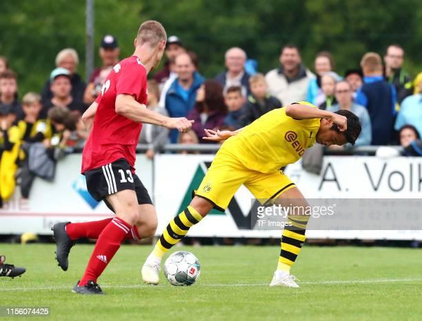 Marcel Bund of FC Schweinberg and Shinji Kagawa of Borussia Dortmund battle for the ball during the preseason friendly match between FC Schweinberg...