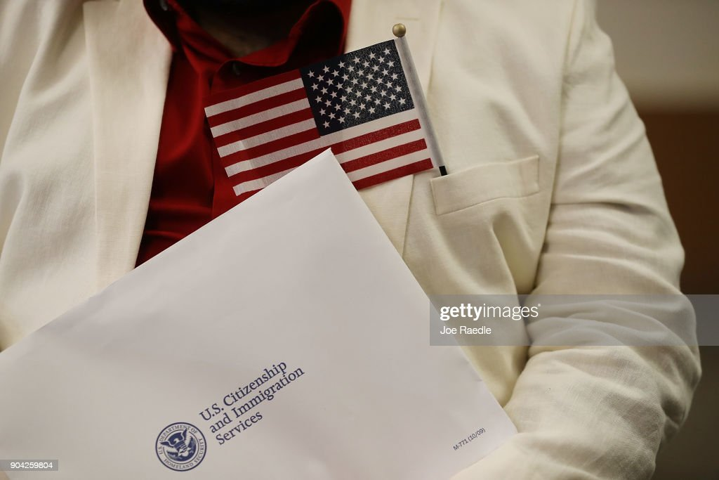 Marcel Cioffi, orginally from Venezuela, prepares to become an American citizen during a U.S. Citizenship & Immigration Services naturalization ceremony at the Hialeah Field Office on January 12, 2018 in Hialeah, Florida. 150 people from different countries around the world took part in the Oath of Allegiance.