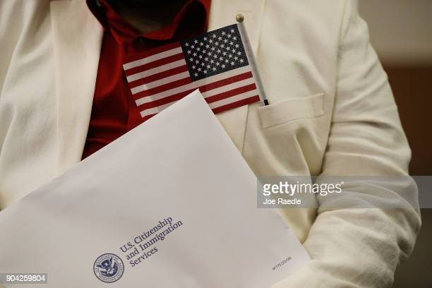 Marcel Cioffi orginally from Venezuela prepares to become an American citizen during a US Citizenship Immigration Services naturalization ceremony at...
