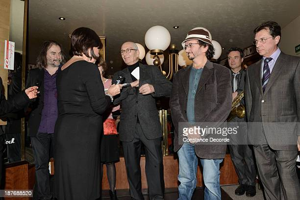 Marcel Cohen and Philippe Rahmy Prix Wepler winners posing with MarieRose Guarnieri and Michel Bessieres speaking on the Prix Wepler 2013 Literary...