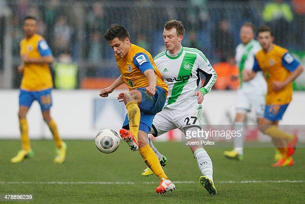 Marcel Correia of Braunschweig and Maximilian Arnold of Wolfsburg compete for the ball during the Bundesliga match between Eintracht Braunschweig and...