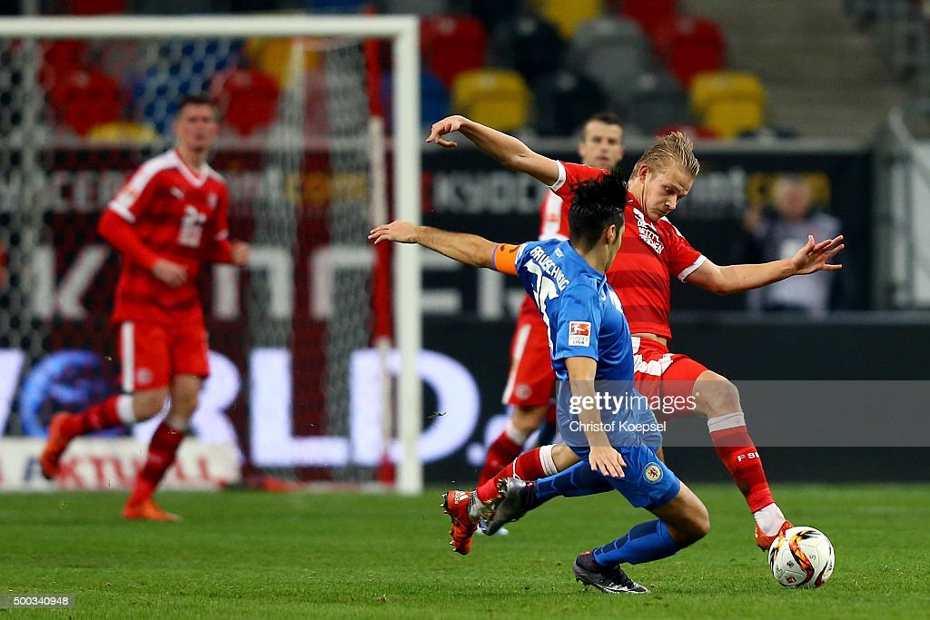 Marcel Correia of Braunschweig (L) challenges Joel Pohjanpalo of Duesseldorf during the Second Bundesliga match between Fortuna Duesseldorf and Eintracht Braunschweig at Esprit-Arena on December 7, 2015 in Duesseldorf, Germany.