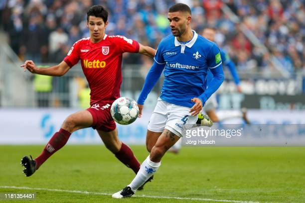 Marcel Correia of SSV Jahn Regensburg and Victor Palsson of SV Darmstadt 98 during the Second Bundesliga match between SV Darmstadt 98 and SSV Jahn...