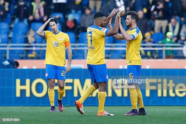Marcel Correia Philemon OfosuAyeh and Quirin Moll of Braunschweig celebrate after the Second Bundesliga match between Eintracht Braunschweig and TSV...