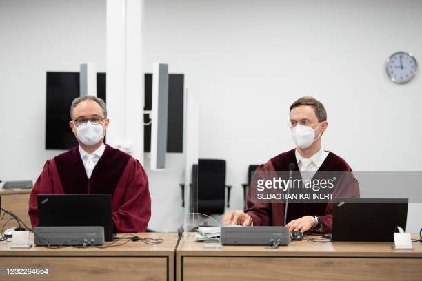Marcel Croissant , Attorney General and Marco Mayer, Attorney General sit at the start of the trial of a Syrian jihadist accused of stabbing a German...