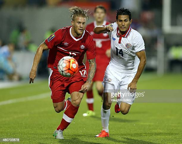 Marcel De Jong of Canada and Deyver Vega of Costa Rica battle for the ball during the 2015 CONCACAF Gold Cup Group B match between Canada and Costa...