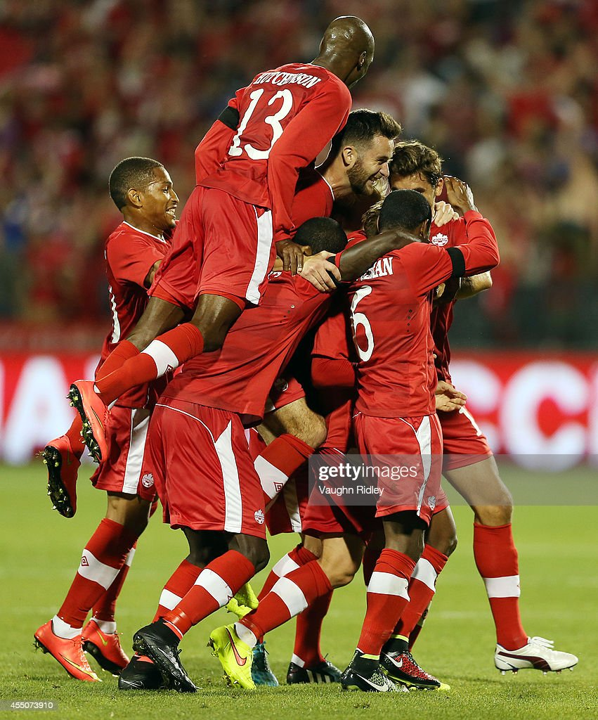 Marcel De Jong of Canada (hidden) celebrates his goal with teammates during the International Friendly match between Canada and Jamaica at BMO Field on September 09, 2014 in Toronto, Ontario, Canada.
