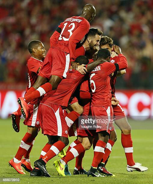Marcel De Jong of Canada celebrates his goal with teammates during the International Friendly match between Canada and Jamaica at BMO Field on...