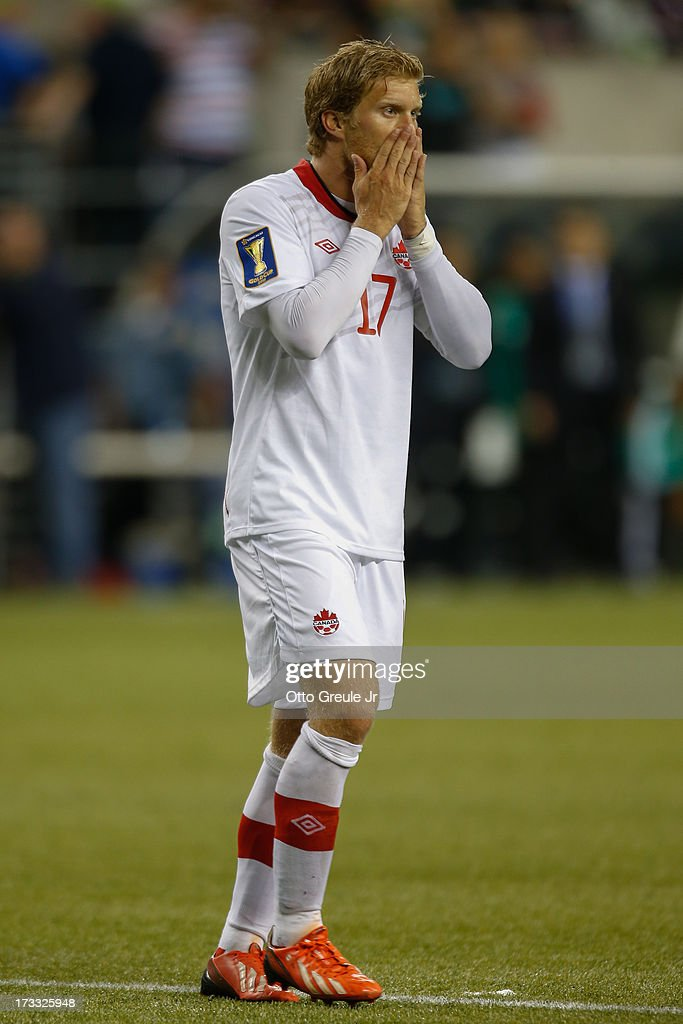 Marcel De Jong #17 of Canada reacts after missing a goal against Mexico at CenturyLink Field on July 11, 2013 in Seattle, Washington. Mexico defeated Canada 2-0.