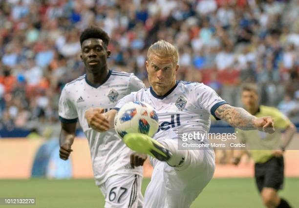 Marcel de Jong of the Vancouver Whitecaps kicks the ball in front of Alphonso Davies of the Vancouver Whitecaps at BC Place on July 28 2018 in...