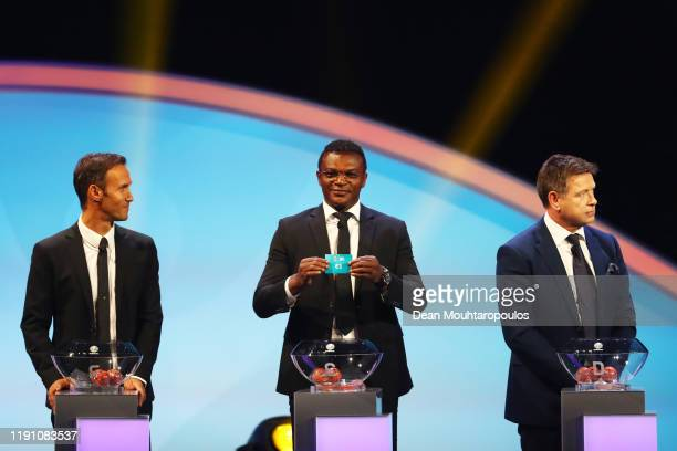 Marcel Desailly, draws group E1 from the pot as Ricardo Carvalho and John Sivebaek look on during the UEFA Euro 2020 Final Draw Ceremony at the...