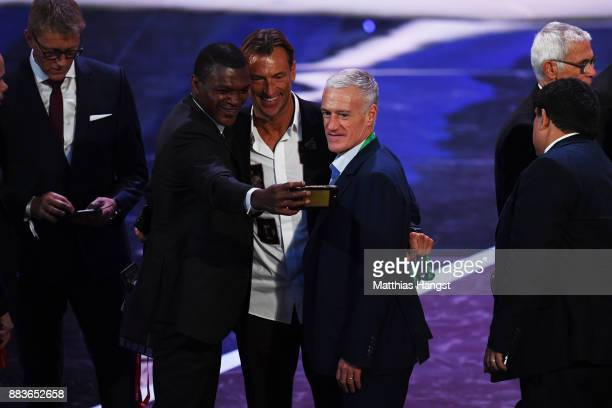 Marcel Desailly Herve Renard Manager of Morocco and Didier Deschamps Manager of France takes a selfie during the Final Draw for the 2018 FIFA World...