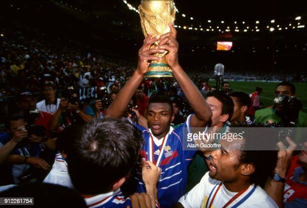 Marcel Desailly of France celebrates the victory after the Soccer World Cup Final between Brazil and France on July 12 1998 in Paris Saint Denis...