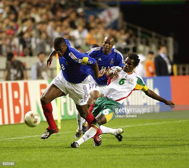 Marcel Desailly of France is tackled by Aliou Cisse of Senegal during the France v Senegal Group A World Cup Group Stage match played at the Seoul...