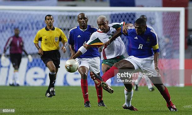 Marcel Desailly of France tackles El Hadji Diouf of Senegal during the France v Senegal Group A World Cup Group Stage match played at the Seoul World...