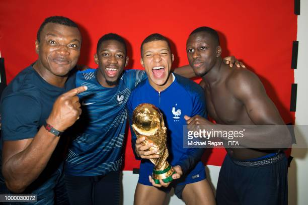 Marcel Desailly Ousmane Dembele Kylian Mbappé and Benjamin Mendy of France pose with the Champions World Cup trophy after the 2018 FIFA World Cup...