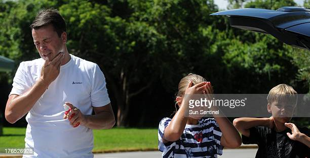 Marcel Deveny and his kids Lonneke and Yorrick put on insect repellent for a walk in Everglades National Park on August 8 where conditions have been...