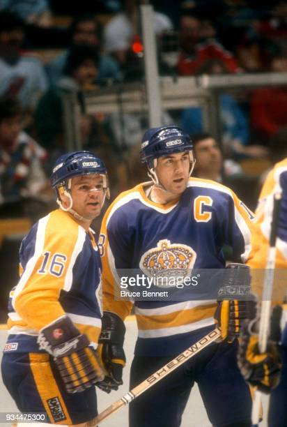 Marcel Dionne and Dave Taylor of the Los Angeles Kings celebrate a goal during an NHL game against the New Jersey Devils on February 22 1986 at the...