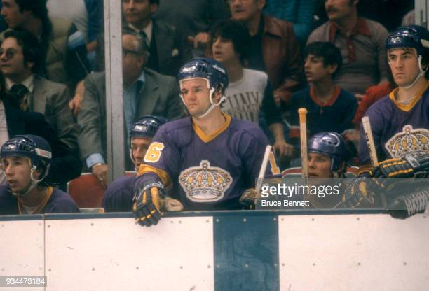 Marcel Dionne and Dave Taylor of the Los Angeles Kings watch the action from the bench during the 1980 Preliminary Round against the New York...