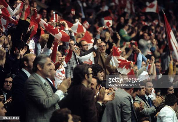 Marcel Dionne and Stan Mikita of Canada cheer with other players and Canadian fans during the 1972 Summit Series at the Luzhniki Ice Palace in...