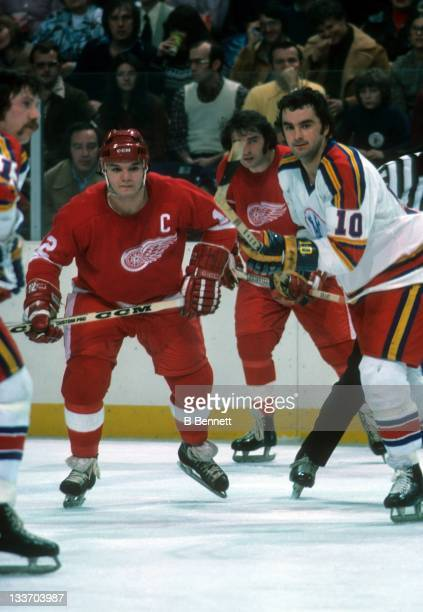 Marcel Dionne of the Detroit Red Wings and Guy Charron of the Kansas City Scouts look for the puck after the faceoff during their game on January 4,...