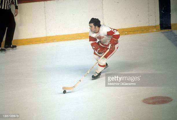 Marcel Dionne of the Detroit Red Wings skates with the puck during an NHL game circa 1972 at the Detroit Olympia in Detroit, Michigan.