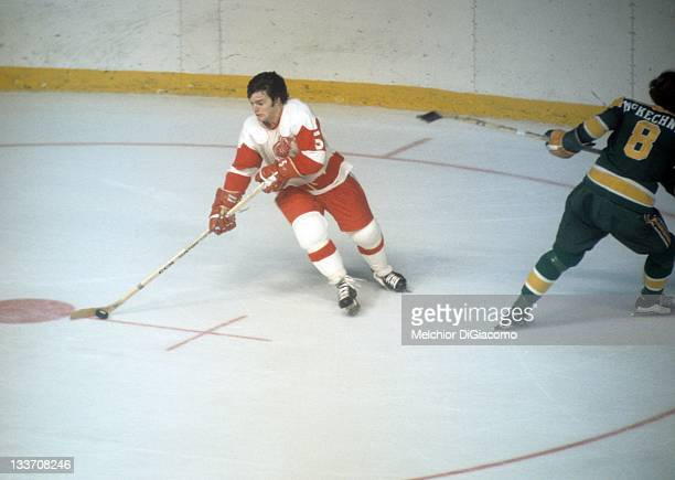 Marcel Dionne of the Detroit Red Wings skates with the puck during an NHL game against the Minnesota North Stars circa 1972 at the Detroit Olympia in...