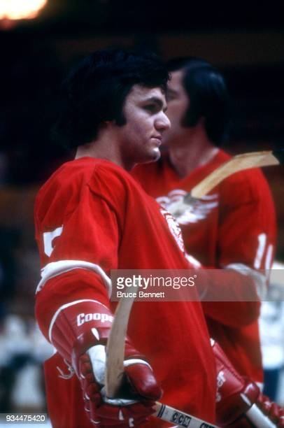 Marcel Dionne of the Detroit Red Wings stands on the ice during warmups prior to an NHL game circa February 1973
