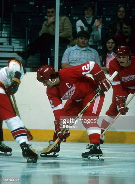 Marcel Dionne of the Detroit Red Wings takes the faceoff during an NHL game against the Kansas City Scouts on January 4, 1975 at the Kemper Arena in...