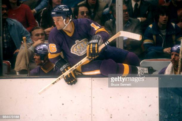 Marcel Dionne of the Los Angeles Kings climbs over the boards to join the action during the 1980 Preliminary Round against the New York Islanders...