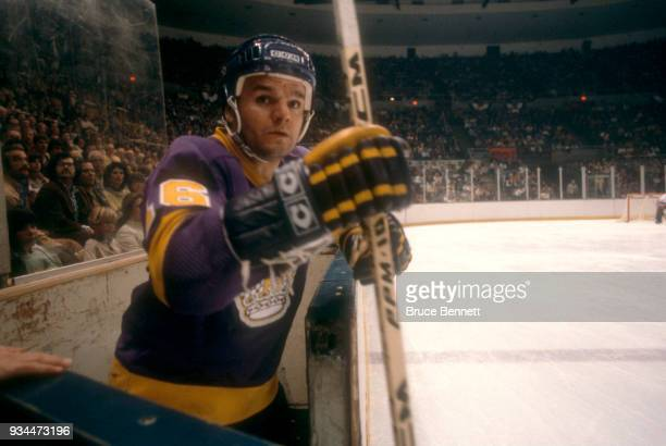 Marcel Dionne of the Los Angeles Kings gets ready to join the action after sitting in the penalty box during the 1980 Preliminary Round against the...