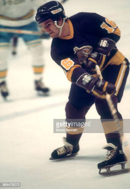 Marcel Dionne of the Los Angeles Kings passes the puck during an NHL game against the California Golden Seals circa 1975 at the Oakland Coliseum in...