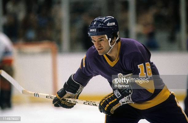 Marcel Dionne of the Los Angeles Kings skates on the ice during an NHL game against the New York Islanders circa 1980 at the Nassau Coliseum in...