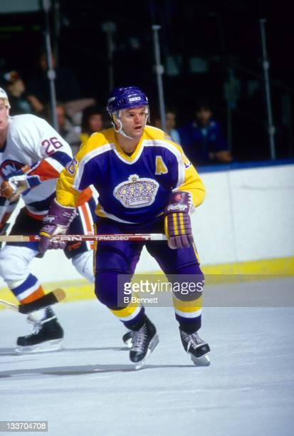 Marcel Dionne of the Los Angeles Kings skates on the ice during an NHL game against the New York Islanders circa 1986 at the Nassau Coliseum in...