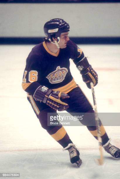 Marcel Dionne of the Los Angeles Kings skates on the ice during an NHL game against the California Golden Seals circa 1975 at the Oakland Coliseum in...