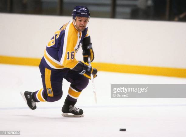 Marcel Dionne of the Los Angeles Kings skates with the puck during an NHL game circa 1981.