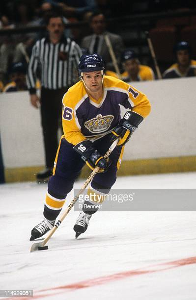 Marcel Dionne of the Los Angeles Kings skates with the puck during an NHL game circa 1980.