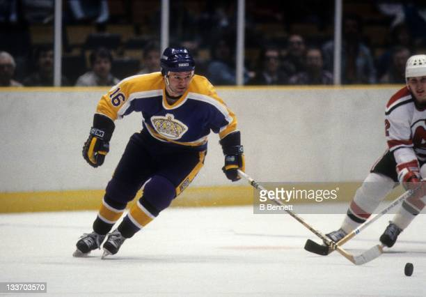 Marcel Dionne of the Los Angeles Kings skates with the puck during an NHL game against the New Jersey Devils on February 14, 1984 at the Brendan...