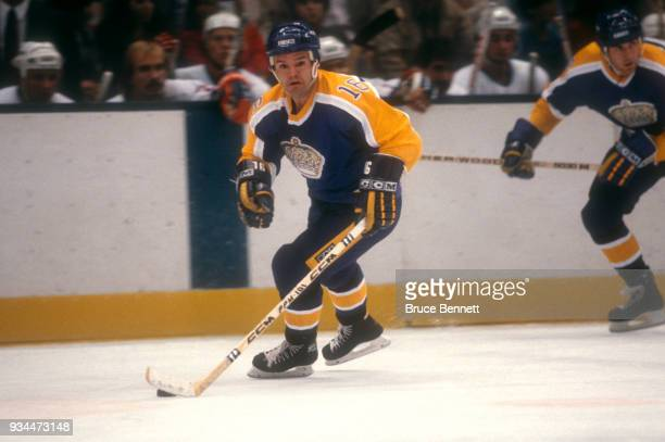 Marcel Dionne of the Los Angeles Kings skates with the puck during an NHL game against the New York Islanders on October 16 1982 at the Nassau...