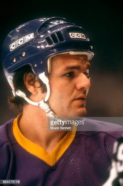 Marcel Dionne of the Los Angeles Kings stands on the ice during an NHL game against the New York Islanders on February 7 1980 at the Nassau Coliseum...