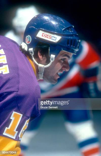 Marcel Dionne of the Los Angeles Kings takes the faceoff during an NHL game against the New York Islanders circa 1979 at the Nassau Coliseum in...