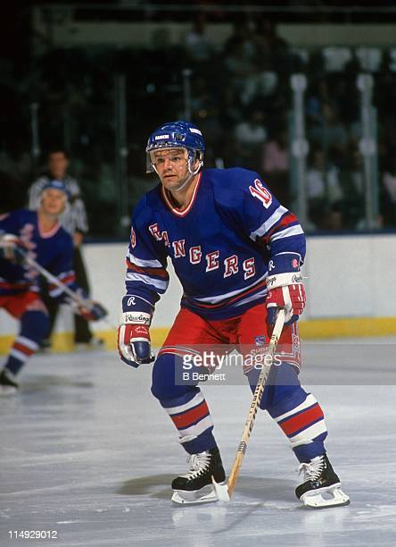 Marcel Dionne of the New York Rangers skates on the ice during an NHL game circa 1987.
