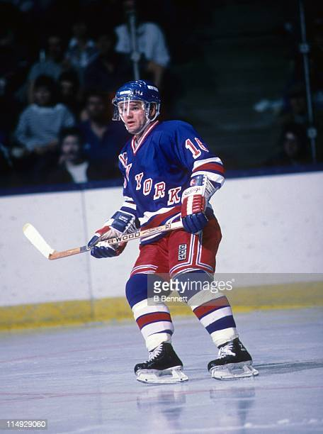 Marcel Dionne of the New York Rangers skates on the ice during an NHL game against the New York Islanders circa 1987 at the Nassau Coliseum in...