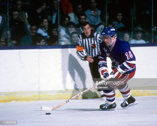 Marcel Dionne of the New York Rangers skates with the puck during an NHL game against the New York Islanders on March 21, 1987 at the Nassau Coliseum...