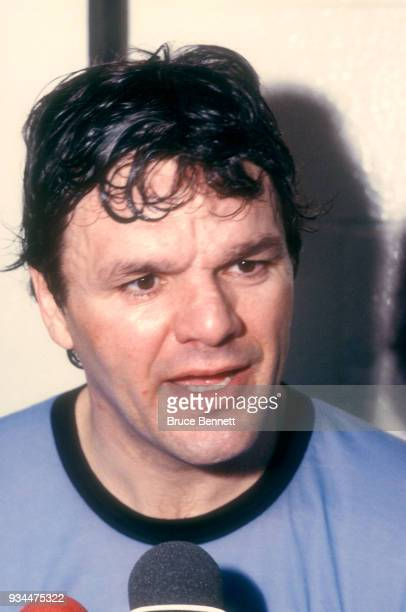 Marcel Dionne of the New York Rangers talks to the media in the locker room after an NHL game circa 1989